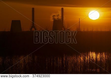 The Heating Plant In The North-west Of St. Petersburg In The Backlight From The Setting Sun On A Spr