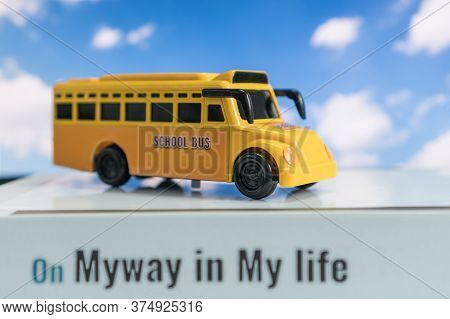 School Bus For Student Transport For Children Transports Service On Stack Books With Word On Myway I
