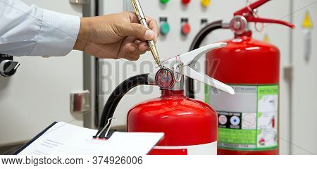 Fire Fighter Are Checking Fire Extinguishers Tank In The Building Concepts Of Fire Prevention Emerge