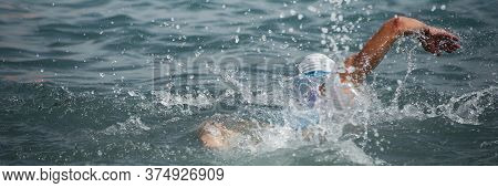 Swim Triathlete Man Swimming Freestyle Crawl In Ocean, Panorama Banner