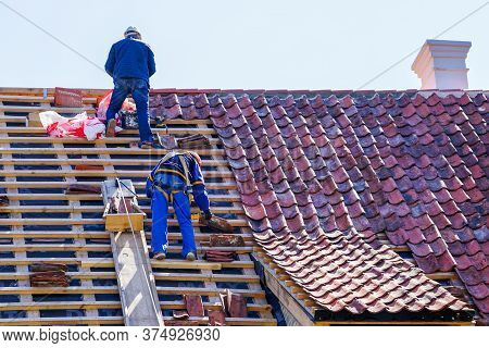 Roof Repair Of A Historic House And Replacement Of Clay Tiles