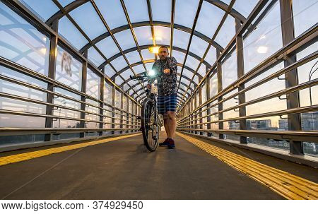 Saint-petersburg.russia.june 23, 2020.a Man With A Bicycle In An Overpass Over The Pulkovo Highway I