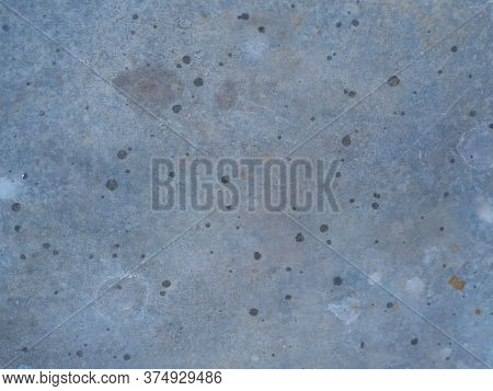 Rust And Oxidized Metal Background. Old Metal Iron Panel With Scratches And Chips. Can Be Used As A