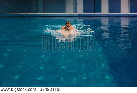Male Swimmer At The Swimming Pool. Underwater Photo. Male Swimmer.