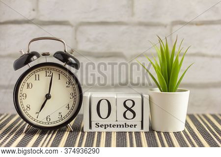 September 8 On A Wooden Calendar Next To The Alarm Clock.september Day, Empty Space For Text.calenda