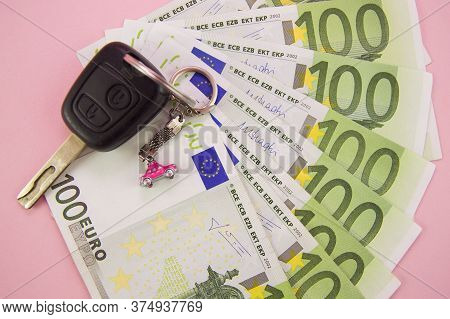 Car Keys Lie On Green Banknotes With A Nominee Of 100 Euros