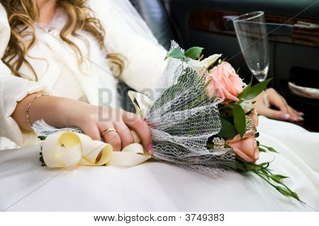 Ring, Hands And  Flowers Of The Bride