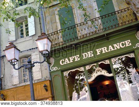 L'isle Sur La Sorgue, France-august 11,2019: Cafe De France At The Place De La Liberte, Provence, Lu