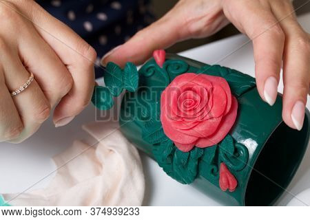 Woman Glues Polymer Clay Roses To A Mug. Polymer Clay Of Different Colors. Crafts From Polymer Clay.