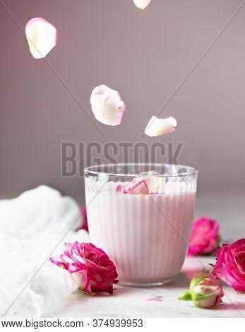 Moon Milk Prepares With Pink Rose Flower. Trendy Bedtime Drink Form Ayurvedic Traditions