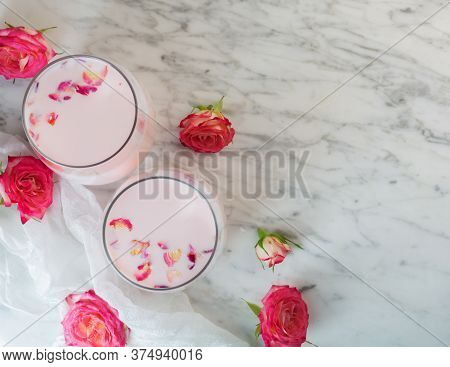 Moon Milk Prepares With Pink Rose Flower. Trendy Relaxing Bedtime Drink Form Ayurvedic Traditions. T