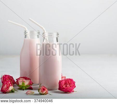 Moon Milk Prepares With Pink Rose Flower In Two Bottles. Trendy Relaxing Bedtime Drink Form Ayurvedi
