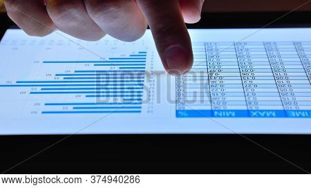 Hand Of Trader Scans On Digital Tablet Online Stock Market. Business And Financial Success Concept.