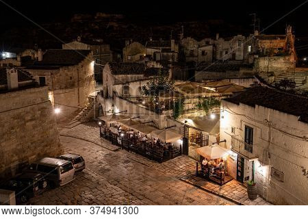 Matera, Italy - September 19, 2019: Evening View Of The City Of Matera, Italy, With The Colorful Lig