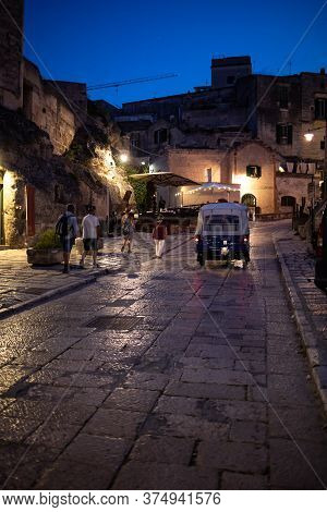 Matera, Italy - September 18, 2019:tourists On A Piaggio Ape Calessino Used As A Tourist Taxi In The