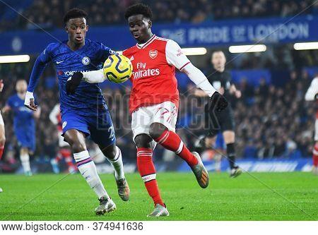 London, England - January 21, 2020: Callum Hudson-odoi Of Chelsea And Bukayo Saka Of Arsenal Picture