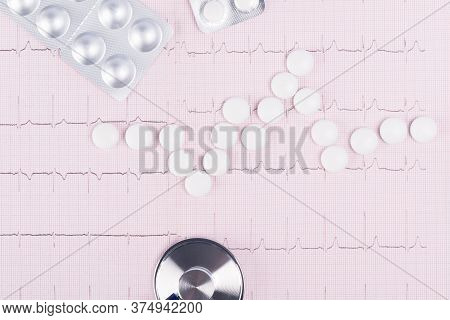 Paper With The Readings Of The Heartbeat With White Pills, Close-up Background