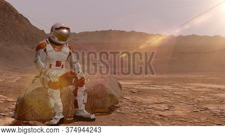 Astronaut Sitting On Mars And Admiring The Scenery. Exploring Mission To Mars. Futuristic Colonizati