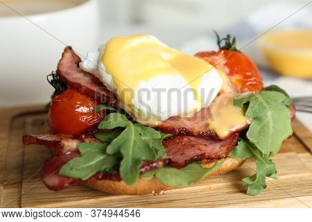 Delicious Egg Benedict Served On Wooden Board, Closeup