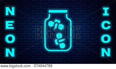 Glowing Neon Fireflies Bugs In A Jar Icon Isolated On Brick Wall Background. Vector