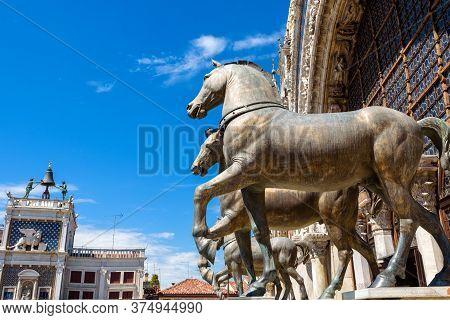 Basilica Di San Marco (saint Mark) Detail, Ancient Bronze Horses, Venice, Italy. Old Sculpture Is Mo