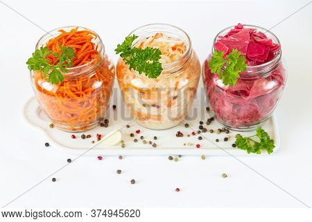 Fermented And Pickled Sauerkraut Red Cabbage Carrot In Glass Jars