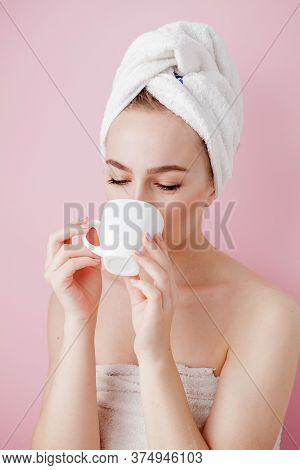 Portrait Of Beautiful Girl In Bathrobe With A Cup Of Tea, Relaxation Concept Blonde Woman Wearing Ba