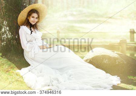 Romantic Woman Victorian Retro Style, Fashion Model In White Dress Wide Brim Hat Reading Book, Outdo