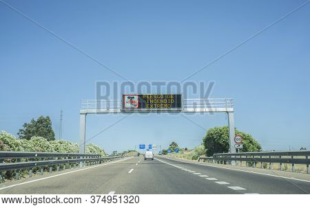 Extreme Fire Hazard Sign On Highway. Information In Spanish