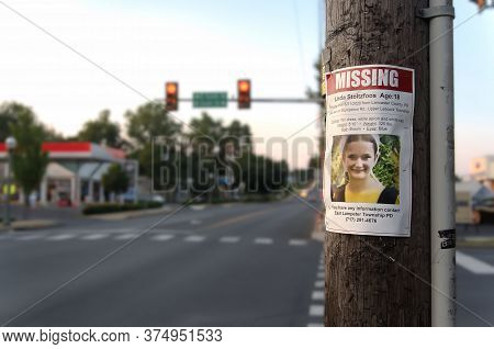 Lititz, Pennsylvania/United States - July 3 2020: Missing sign on a telephone pole for missing Amish teenager Linda Stoltzfoos, in Lititz, Pennsylvania