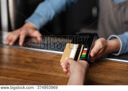Fast Payment For Drinks. Girl Uses Credit Card, Barman Holds Terminal On Bar Counter, Cropped, Free