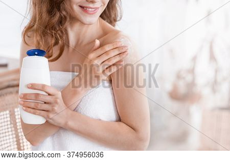 Cropped Of Blondy Girl Applying Body Lotion On Her Skin, Home Interior, Empty Space