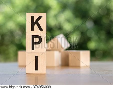 Letter Block In Word Kpi -abbreviation Of Key Performance Indicator On Wood Background