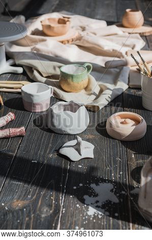 Art Of Pottery. Still Life Of Pottery Making Tools, Brushes And Different Ceramic Vases And Bowls In