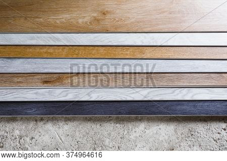 laminate flooring planks variations on concrete floor