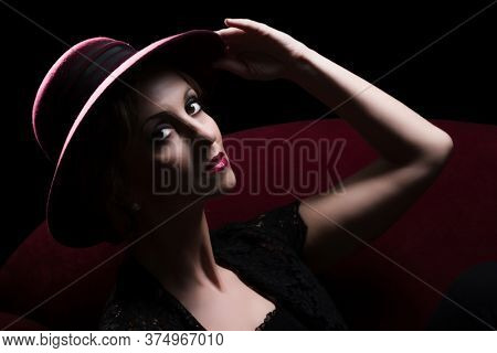 Vintage fancy woman posing like an actress dressed in chanel style