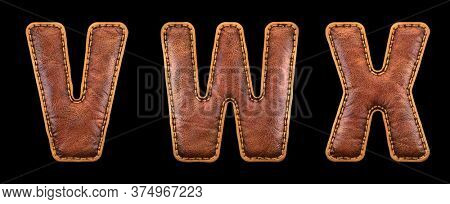 Set of leather letters V, W, X uppercase. 3D render font with skin texture isolated on black background. 3d rendering