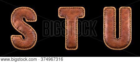 Set of leather letters S, T, U uppercase. 3D render font with skin texture isolated on black background. 3d rendering
