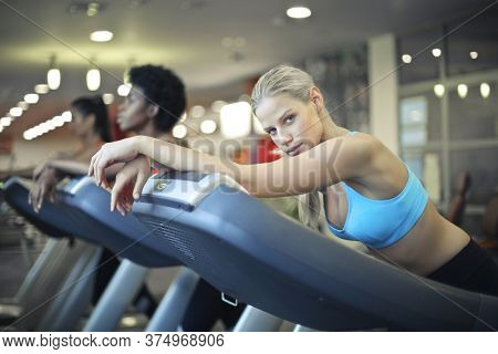 woman uses treadmill in the gym