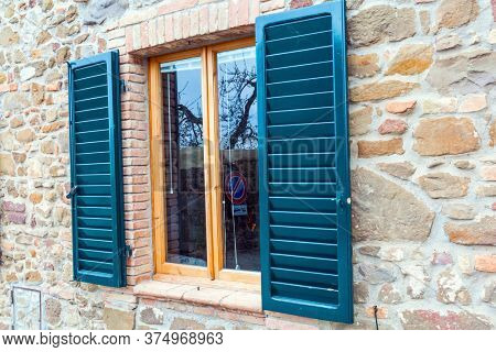 Beautiful element of window decor - shutters. The concept of cognitive, active and photo tourism.