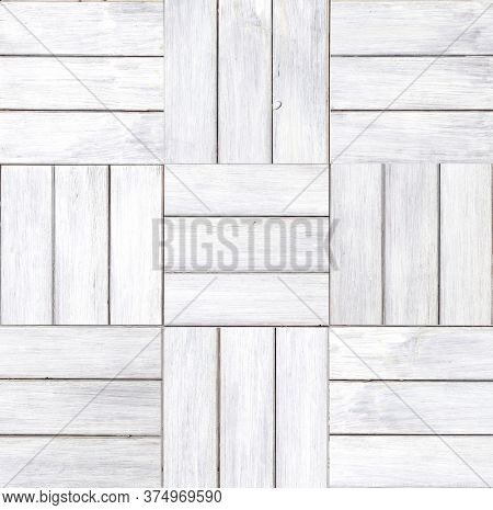 Texture of wooden floor with square elements. Texture of old wood planks with paint of white color. Horizontal or vertical background with white painted boards