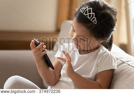 Interested Young Asian Baby Learning Using Smartphone.