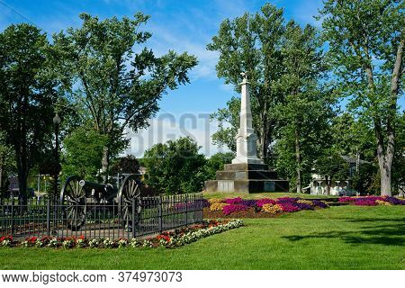 The Township Square In Twinsburg, Ohio, With Civil War Monument, Cannon, And An Array Of Colorful Fl