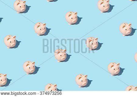 Piggy Bank Izometric Pattern On Bright Light Blue Background. Minimal Flat Lay Texture. Abstract Tre