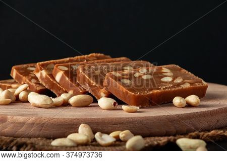 Peanut Sorbet On A Wooden Background. Vegetarian Oriental Sweet With Nuts.