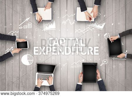 Group of Busy People Working in an Office with CAPITAL EXPENDITURE inscription, succesfull business concept