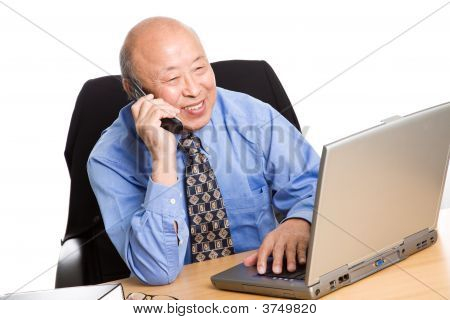Working Senior Asian Businessman