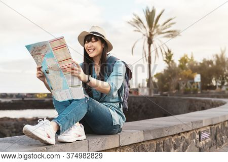Travel Asian Girl Looking Map During City Tour - Young Happy Woman Doing Old Town Excursion Discover
