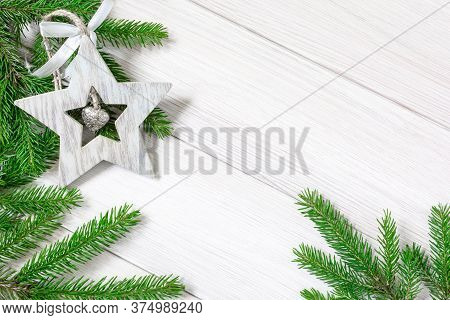 Christmas Or New Year Decorations Background: Tree Branches And Christmas Tree Toy In The Form Of A