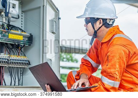 Engineers Upload Data Of Power Energy To A Laptop For Checking The Performance Of The Solar Panel To